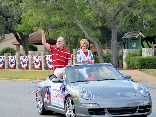 Riding in Car as Grand Marshals